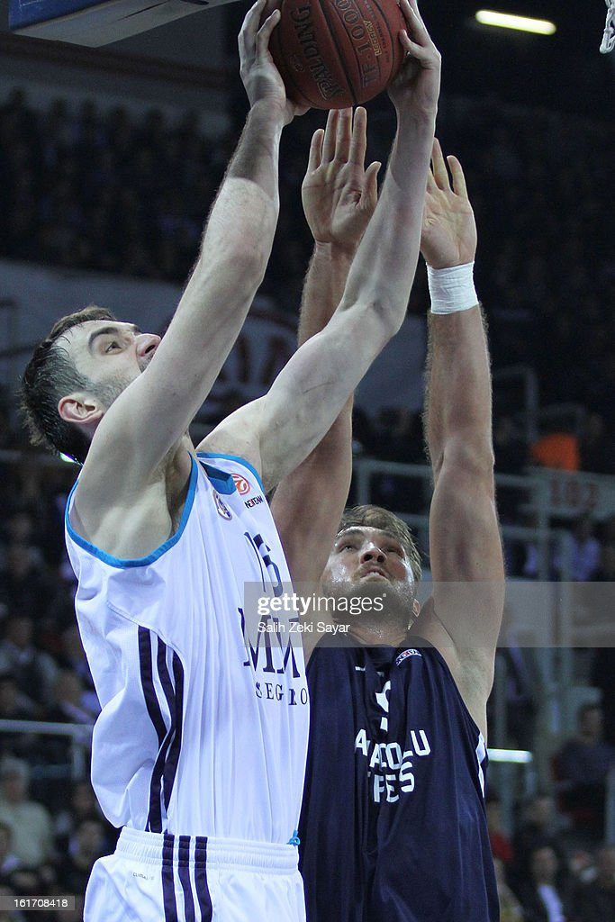 Mirza Begic #16 of Real Madrid competes with Semih Erden #9 of Anadolu Efes during the 2012-2013 Turkish Airlines Euroleague Top 16 Date 7 between Anadolu EFES Istanbul v Real Madrid at Abdi Ipekci Sports Arena on February 14, 2013 in Istanbul, Turkey.