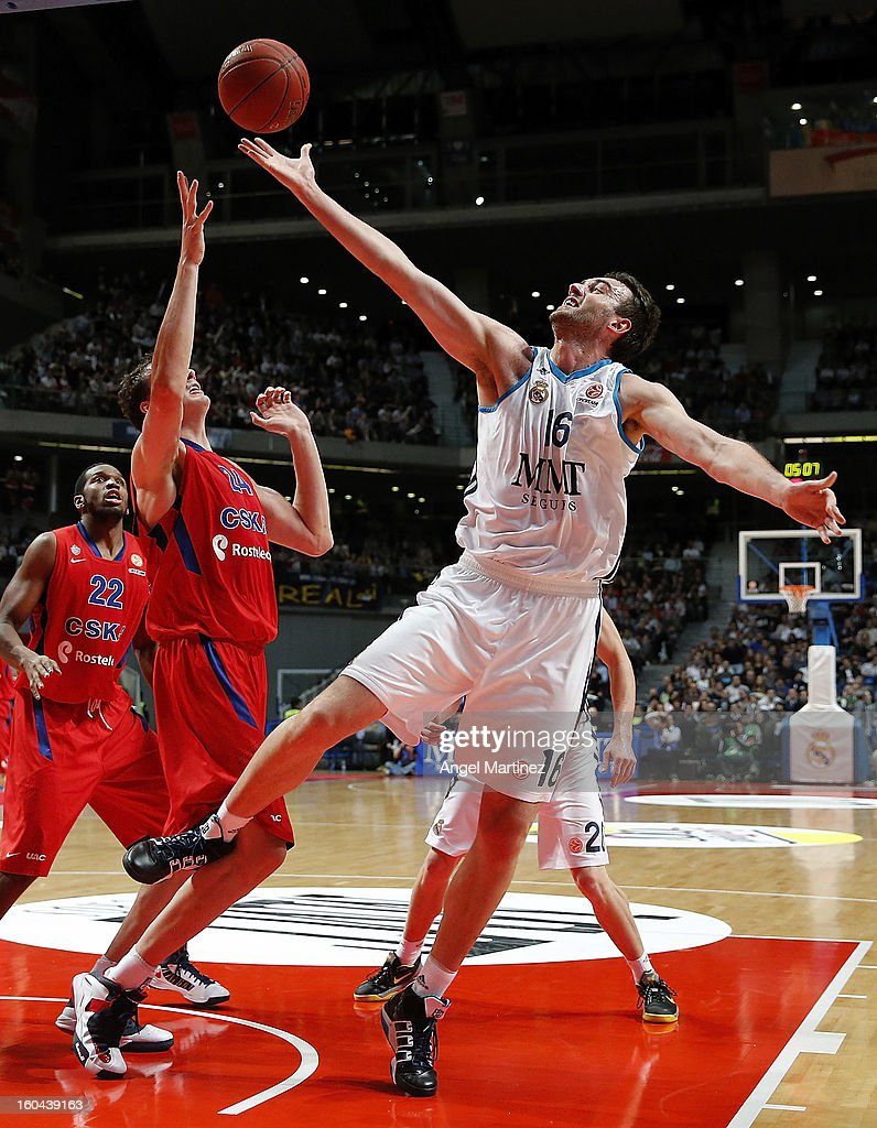 Mirza Begic #16 of Real Madrid grabs a rebound against Sasha Kaun #24 of CSKA Moscow during the Turkish Airlines Euroleague Top 16 game at Palacio de los Deportes on January 31, 2013 in Madrid, Spain.