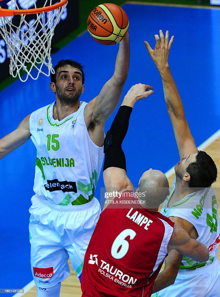 Mirza Begic of Slovenia and Bostjan Nachbar of Slovenia vies with Maciej Lampe of Poland during the group C qualification match to EuroBasket 2013...