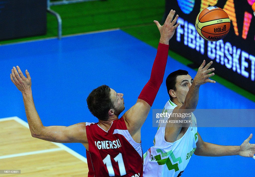 Mirza Begic of Slovenia vies with Michal Ignerski of Poland during the group C qualification match to EuroBasket 2013 Championships between their...