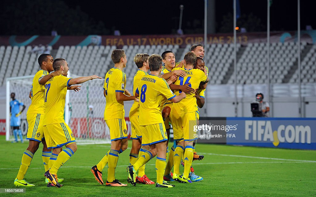 Mirza Halvadzic of Sweden celebrates scoring the third goal with teamates during the FIFA U17 group F match between Sweden and Nigeria at Khalifa Bin Zayed Stadium on October 22, 2013 in Al Ain, United Arab Emirates.