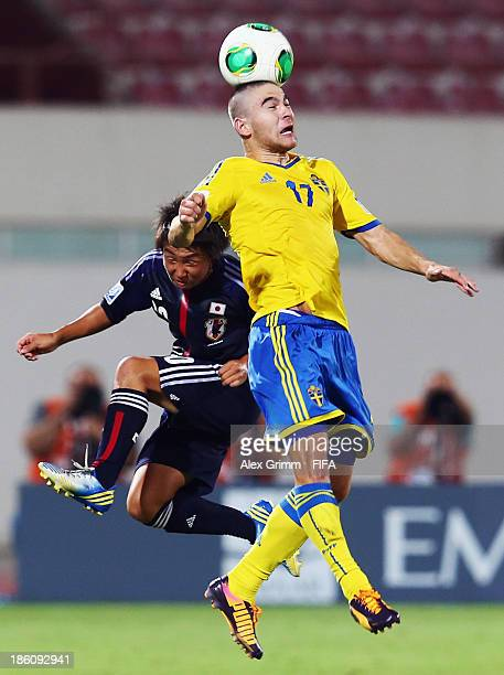 Mirza Halvadzic of Sweden jumps for a header with Daisuke Sakai of Japan during the FIFA U17 World Cup UAE 2013 Round of 16 match between Japan and...
