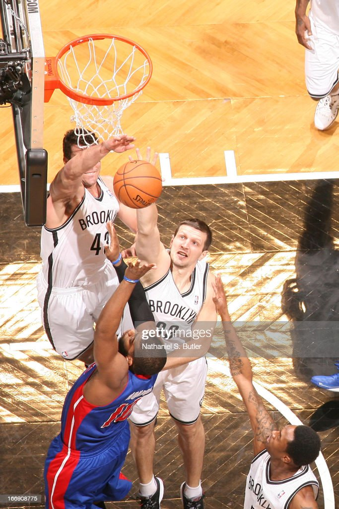 Mirza Teletovic #33 of the Brooklyn Nets blocks a shot against Greg Monroe #10 of the Detroit Pistons on April 17, 2013 at the Barclays Center in the Brooklyn borough of New York City.