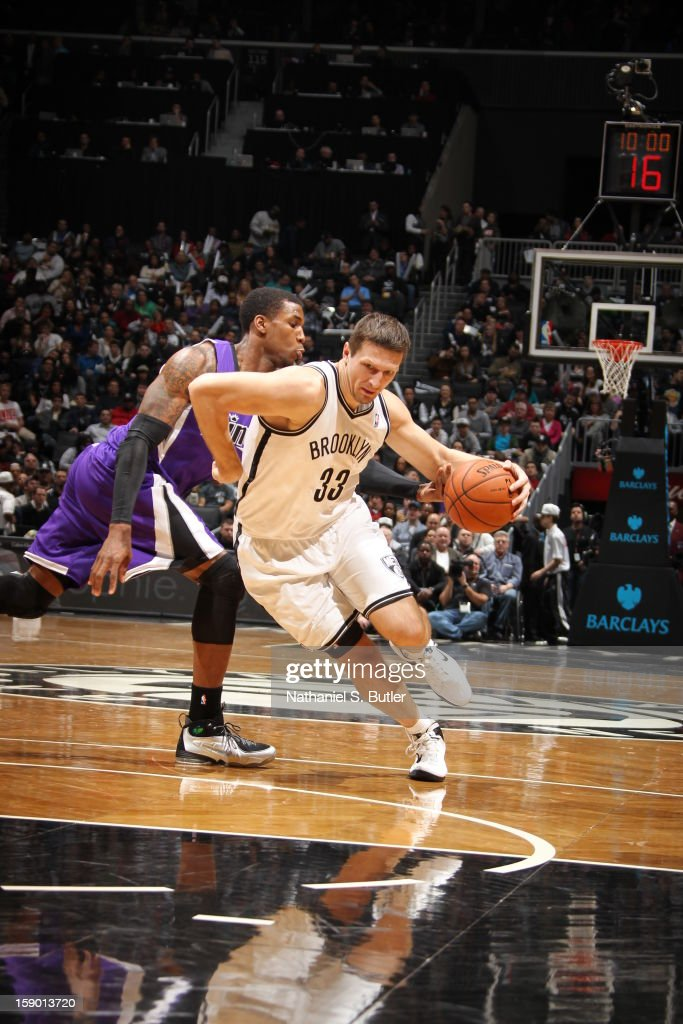 Mirza Teletovic #33 of the Brooklyn Nets drives against Thomas Robinson #0 of the Sacramento Kings on January 5, 2013 at the Barclays Center in the Brooklyn borough of New York City.