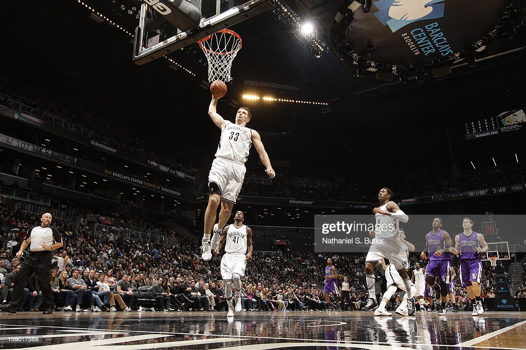 Mirza Teletovic #33 of the Brooklyn Nets dunks against the Sacramento Kings on January 5, 2013 at the Barclays Center in the Brooklyn borough of New York City.