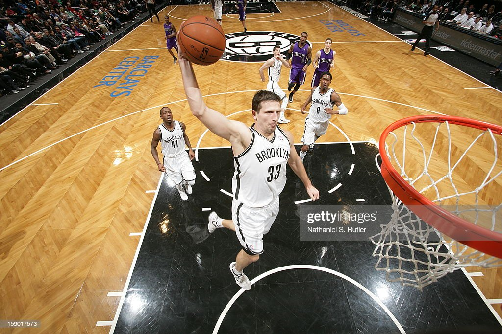 <a gi-track='captionPersonalityLinkClicked' href=/galleries/search?phrase=Mirza+Teletovic&family=editorial&specificpeople=2255667 ng-click='$event.stopPropagation()'>Mirza Teletovic</a> #33 of the Brooklyn Nets dunks against the Sacramento Kings on January 5, 2013 at the Barclays Center in the Brooklyn borough of New York City.
