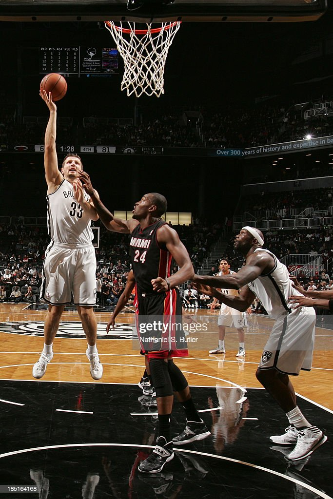 Mirza Teletovic #33 of the Brooklyn Nets goes up to shoot during a preseason game against the Miami Heat at the Barclays Center on October 17, 2013 in the Brooklyn borough of New York City.