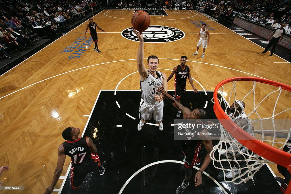 <a gi-track='captionPersonalityLinkClicked' href=/galleries/search?phrase=Mirza+Teletovic&family=editorial&specificpeople=2255667 ng-click='$event.stopPropagation()'>Mirza Teletovic</a> #33 of the Brooklyn Nets goes up to shoot during a preseason game against the Miami Heat at the Barclays Center on October 17, 2013 in the Brooklyn borough of New York City.