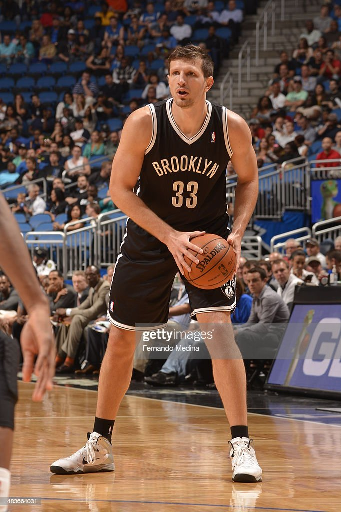 Mirza Teletovic #33 of the Brooklyn Nets looks to pass the ball against the Orlando Magic during the game on April 9, 2014 at Amway Center in Orlando, Florida.