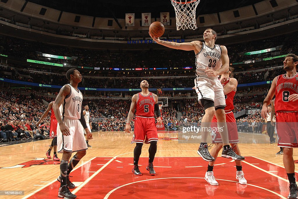 Mirza Teletovic #33 of the Brooklyn Nets shoots a layup against the Chicago Bulls on March 2, 2013 at the United Center in Chicago, Illinois.