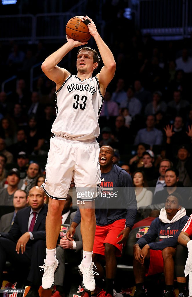 Mirza Teletovic #33 of the Brooklyn Nets shoots a three point shot in the fourth quarter against the Atlanta Hawks at the Barclays Center on January 6, 2014 in the Brooklyn borough of New York City.The Brooklyn Nets defeated the Atlanta Hawks 91-86.