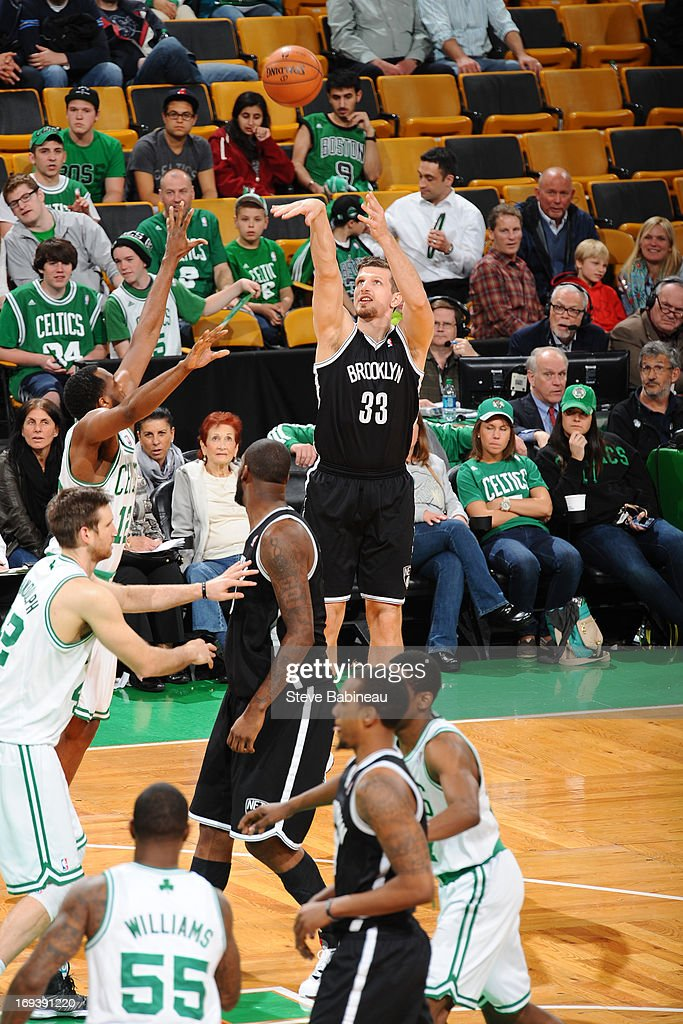 <a gi-track='captionPersonalityLinkClicked' href=/galleries/search?phrase=Mirza+Teletovic&family=editorial&specificpeople=2255667 ng-click='$event.stopPropagation()'>Mirza Teletovic</a> #33 of the Brooklyn Nets shoots against <a gi-track='captionPersonalityLinkClicked' href=/galleries/search?phrase=D.J.+White+-+Basketball+Player&family=editorial&specificpeople=2537103 ng-click='$event.stopPropagation()'>D.J. White</a> #12 of the Boston Celtics on April 10, 2013 at the TD Garden in Boston, Massachusetts.
