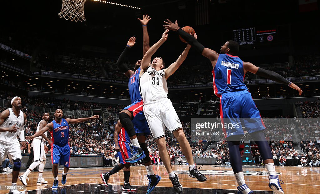 Mirza Teletovic #33 of the Brooklyn Nets shoots against Greg Monroe #10 and Andre Drummond #1 of the Detroit Pistons on April 17, 2013 at the Barclays Center in the Brooklyn borough of New York City.