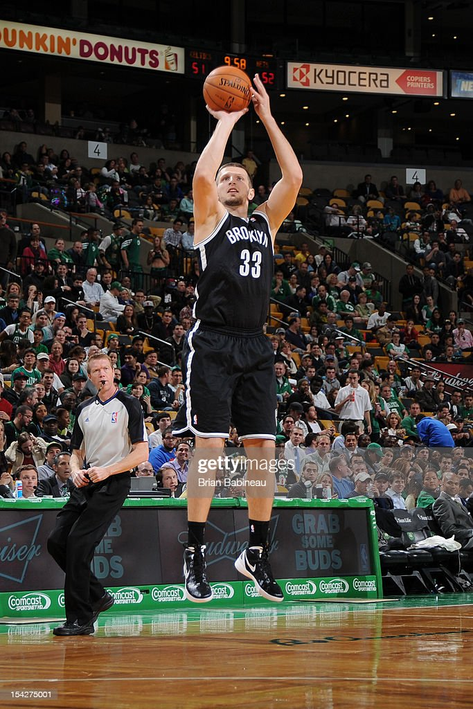 <a gi-track='captionPersonalityLinkClicked' href=/galleries/search?phrase=Mirza+Teletovic&family=editorial&specificpeople=2255667 ng-click='$event.stopPropagation()'>Mirza Teletovic</a> #33 of the Brooklyn Nets shoots against the Boston Celtics on October 16, 2012 at the TD Garden in Boston, Massachusetts.