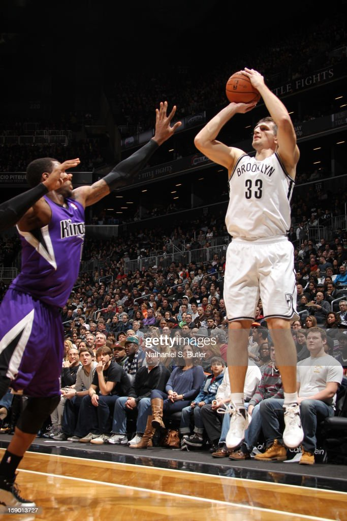 Mirza Teletovic #33 of the Brooklyn Nets shoots against Thomas Robinson #0 of the Sacramento Kings on January 5, 2013 at the Barclays Center in the Brooklyn borough of New York City.