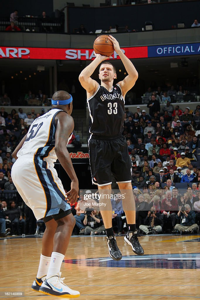 <a gi-track='captionPersonalityLinkClicked' href=/galleries/search?phrase=Mirza+Teletovic&family=editorial&specificpeople=2255667 ng-click='$event.stopPropagation()'>Mirza Teletovic</a> #33 of the Brooklyn Nets shoots against <a gi-track='captionPersonalityLinkClicked' href=/galleries/search?phrase=Zach+Randolph&family=editorial&specificpeople=201595 ng-click='$event.stopPropagation()'>Zach Randolph</a> #50 of the Memphis Grizzlies on January 25, 2013 at FedExForum in Memphis, Tennessee.