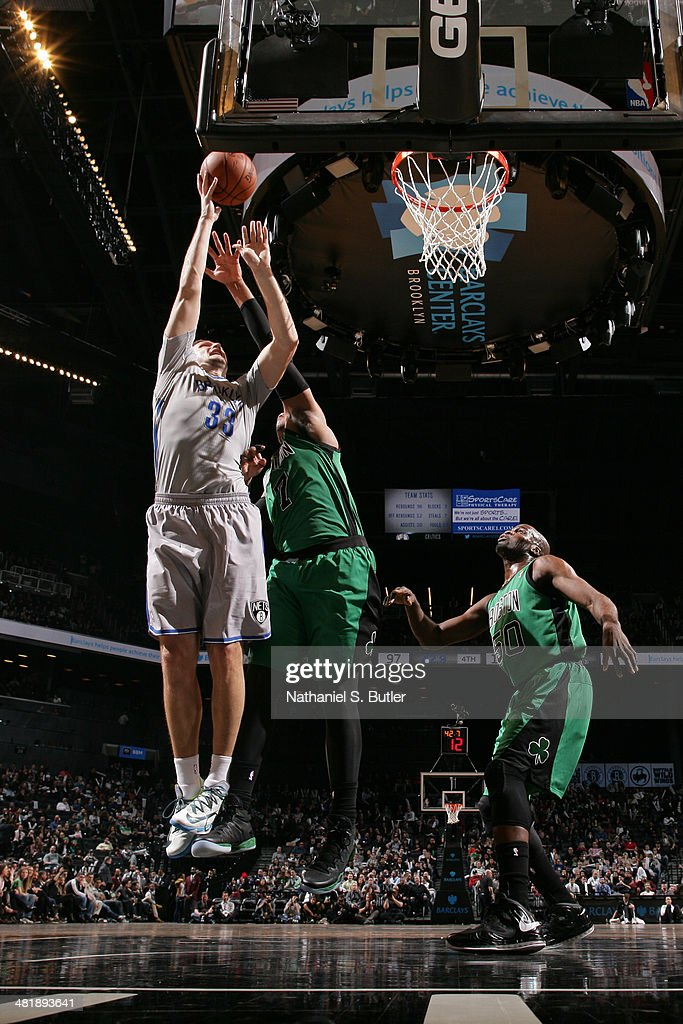 <a gi-track='captionPersonalityLinkClicked' href=/galleries/search?phrase=Mirza+Teletovic&family=editorial&specificpeople=2255667 ng-click='$event.stopPropagation()'>Mirza Teletovic</a> #33 of the Brooklyn Nets takes a shot against the Boston Celtics at the Barclays Center on March 21, 2014 in the Brooklyn borough of New York City.