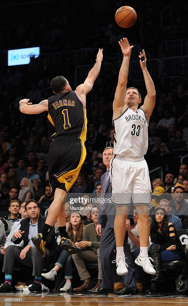 <a gi-track='captionPersonalityLinkClicked' href=/galleries/search?phrase=Mirza+Teletovic&family=editorial&specificpeople=2255667 ng-click='$event.stopPropagation()'>Mirza Teletovic</a> #33 of the Brooklyn Nets takes a shot over <a gi-track='captionPersonalityLinkClicked' href=/galleries/search?phrase=Jordan+Farmar&family=editorial&specificpeople=228137 ng-click='$event.stopPropagation()'>Jordan Farmar</a> #1 of the Los Angeles Lakers during the second half at Barclays Center on November 27, 2013 in the Brooklyn borough of New York City. The Lakers defeat the Nets 99-94.
