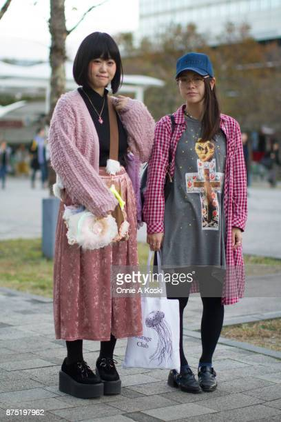 Misa and Aki stop for a quick fashion snap leaving Design Festa vol 46 Misa is wearing a Ogucreeeeem pink knit cardigan Availu pink skirt black...