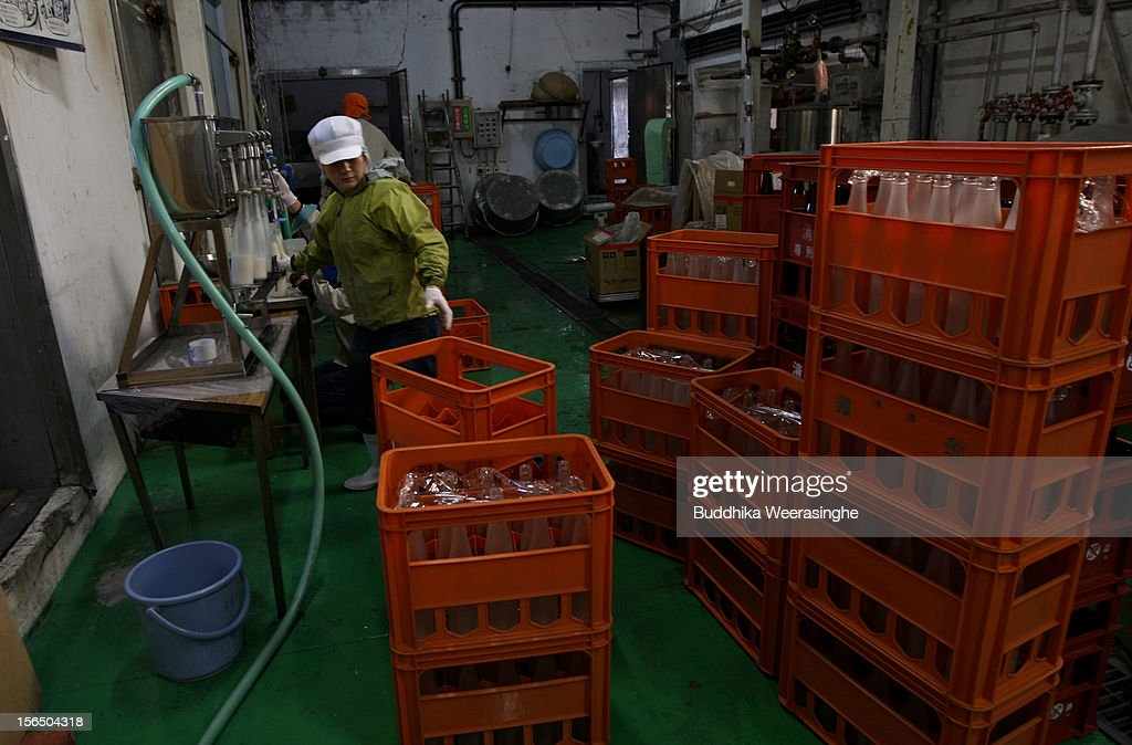Misa Kawaisi, chief sake brew master, crates up sake bottles at Nadagiku-Shozo sake brewery on November 16, 2012 in Himeji, Japan. Kawaishi, one of a few female sake brew masters, is a unique figure in male-diminated sake brewers world. .