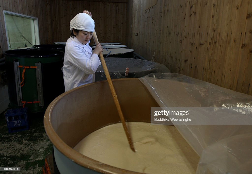 Misa Kawaisi, chief sake brew master, stirs fermenting sake at Nadagiku-Shozo sake brewery on November 16, 2012 in Himeji, Japan. Kawaishi, one of a few female sake brew masters, is an unique figure in male-diminated sake brewers world.