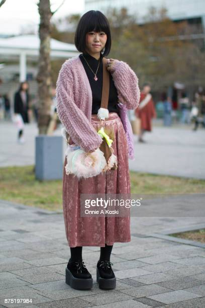 Misa wearing a Ogucreeeeem pink knit cardigan Availu pink skirt black platform shoes from Harajuku a purple resin with gold rose and pink bow pendant...