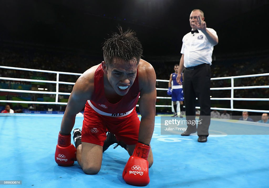 Misael Uziel Rodriguez of Mexico receives a count after a fall in his fight against Hosam Hussein Bakr Abdin of Egypt in the mens middleweight 75kg...