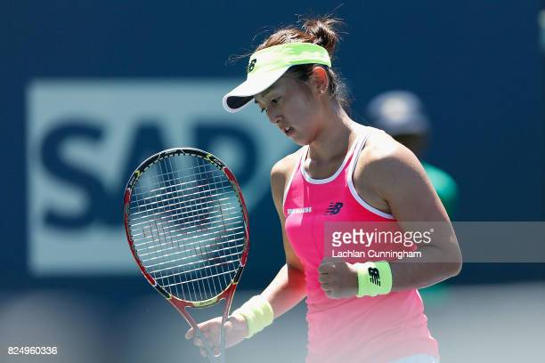 Misaki Doi of Japan celebrates a point against Kayla Day of the United States during day 1 of the Bank of the West Classic at Stanford University...