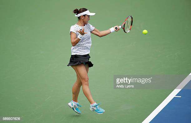 Misaki Doi of Japan hits a return during her match against Jessica Pegula during the Western Southern Open at the Lindner Family Tennis Center on...