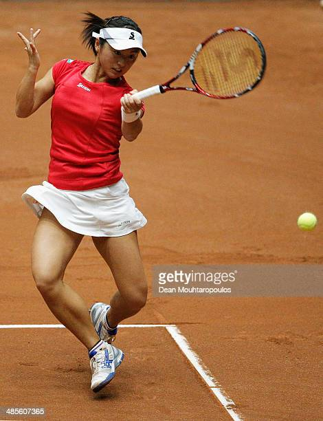 'SHERTOGENBOSCH NETHERLANDS APRIL 19 Misaki Doi of Japan in action against Kiki Bertens of Netherlands during the Fed Cup World Group II Playoff...
