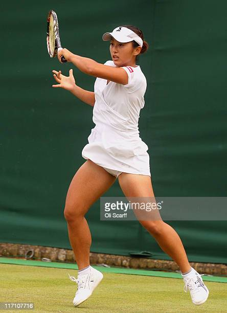 Misaki Doi of Japan in action during her first round match against Bethanie MattekSands of the United States on Day Three of the Wimbledon Lawn...