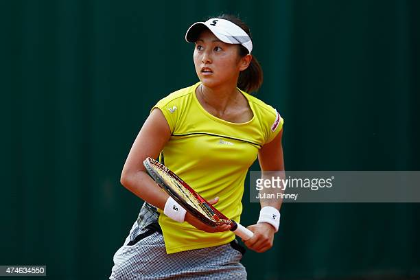 Misaki Doi of Japan looks on during her Women's Singles match against Petra Cetkovska of France on day one of the 2015 French Open at Roland Garros...