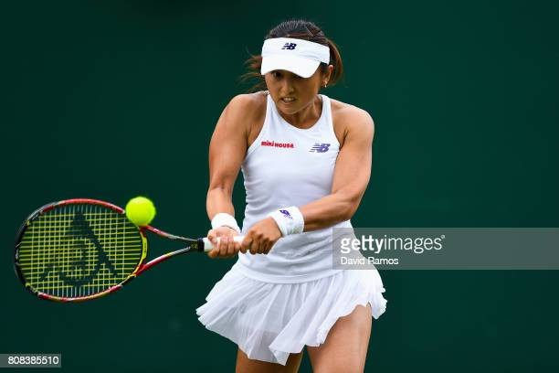 Misaki Doi of Japan plays a backhand during her Ladies Singles first round match against Kristen Flipkins of Belgium on day two of the Wimbledon Lawn...