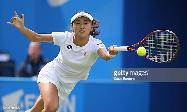 Misaki Doi of Japan plays a backhand during her women's singles first round match against Johanna Konta of Great Britain on day four of the WTA Aegon...