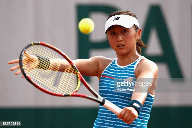 Misaki Doi of Japan plays a backhand during the ladies singles first round match against Sara Errani of Italy on day two of the 2017 French Open at...