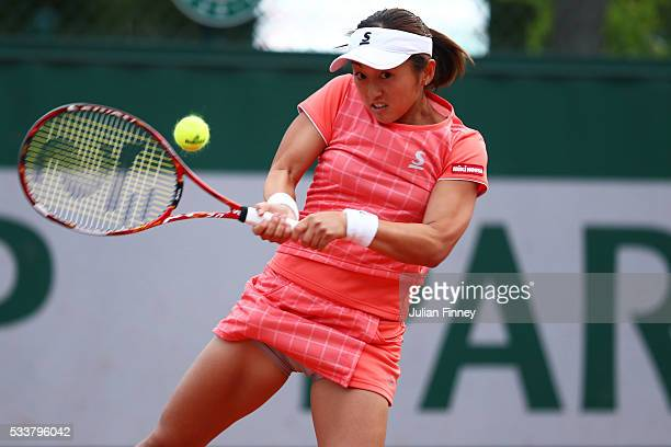 Misaki Doi of Japan plays a backhand during the Women's Singles first round match against Samantha Stosur of Australia on day two of the 2016 French...
