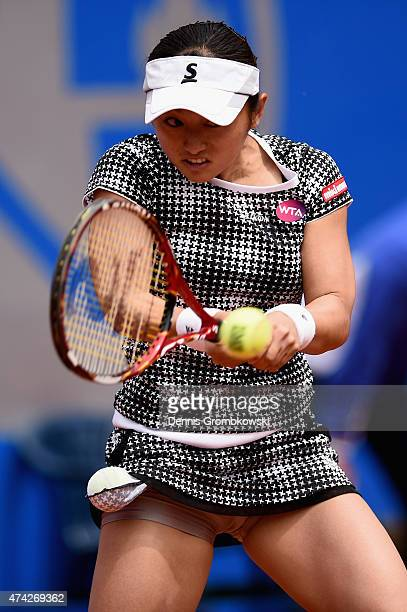 Misaki Doi of Japan plays a backhand in her match against Angelique Kerber of Germany during Day six of the Nuernberger Versicherungscup 2015 on May...