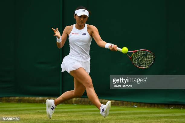 Misaki Doi of Japan plays a forehand during her Ladies Singles first round match against Kristen Flipkins of Belgium on day two of the Wimbledon Lawn...
