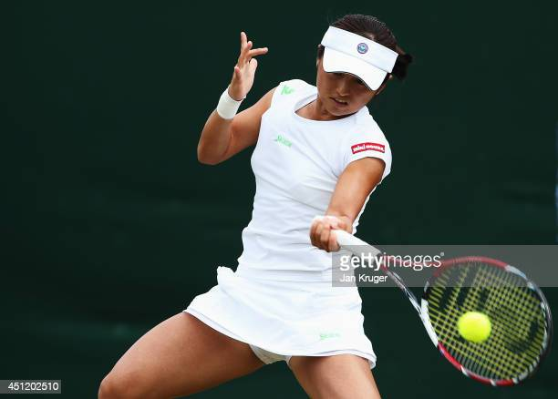 Misaki Doi of Japan plays a forehand shot during her Ladies' Singles second round match against Ekaterina Makarova of Russia on day three of the...
