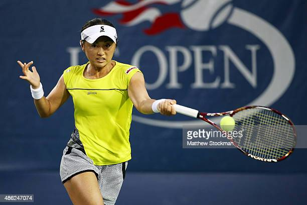 Misaki Doi of Japan returns a shot against Belinda Bencic of Switzerland during their Women's Singles Second Round match on Day Three of the 2015 US...
