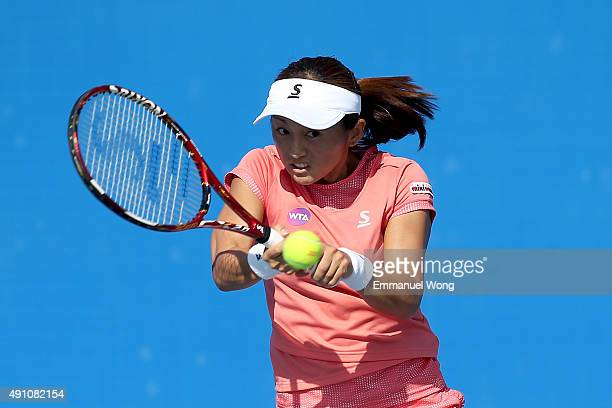 Misaki Doi of Japan returns a shot against Lucie Hradecka of The Czech Republic during the day one of the 2015 China Open at the China National...