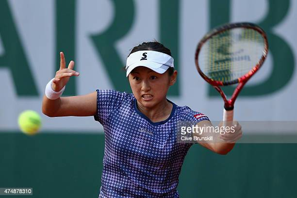 Misaki Doi of Japan returns a shot during her Women's Singles match against Ana Ivanovic of Serbia during day four of the 2015 French Open at Roland...