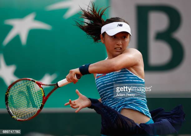 Misaki Doi of Japan returns the ball during the ladies singles first round match against Sara Errani of Italy on day two of the 2017 French Open at...