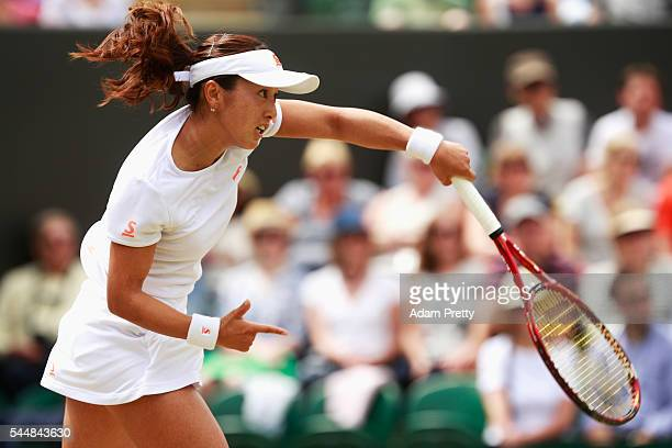 Misaki Doi of Japan serves during the Ladies Singles fourth round match against Angelique Kerber of Germany on day seven of the Wimbledon Lawn Tennis...