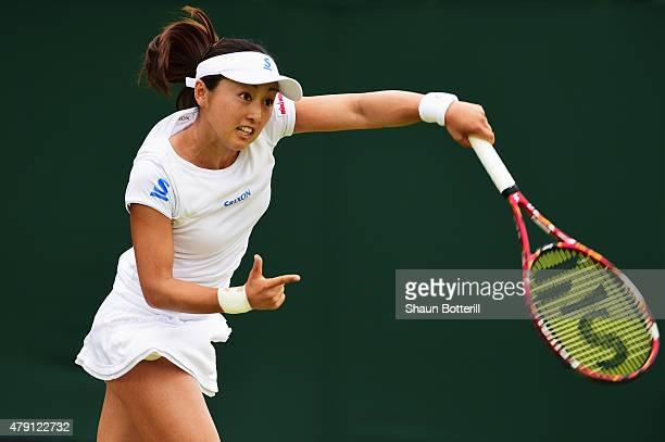 Misaki Doi of Japan serves in her Ladies Doubles First Round match with Stephanie Vogt of Liechtenstein against Johanna Konta of Great Britain and...