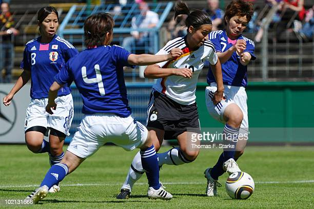 Misaki Kobayashi and Shoko Yamada of Japan tackle Dzsenifer Marozsan of Germany during the DFB Women's U20 friendly match between Germany and Japan...