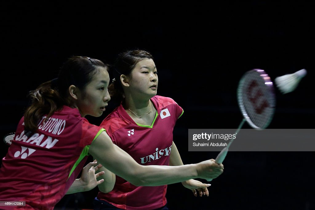 Misaki Matsumoto and <a gi-track='captionPersonalityLinkClicked' href=/galleries/search?phrase=Ayaka+Takahashi&family=editorial&specificpeople=8671069 ng-click='$event.stopPropagation()'>Ayaka Takahashi</a> of Japan in action during the women's doubles final of the 2015 Singapore Open at Singapore Indoor Stadium on April 12, 2015 in Singapore.