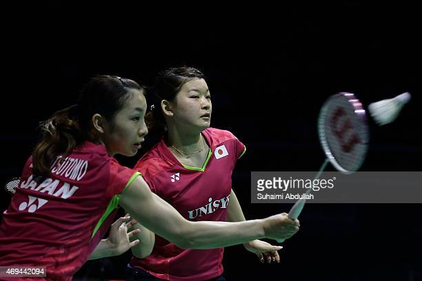 Misaki Matsumoto and Ayaka Takahashi of Japan in action during the women's doubles final of the 2015 Singapore Open at Singapore Indoor Stadium on...
