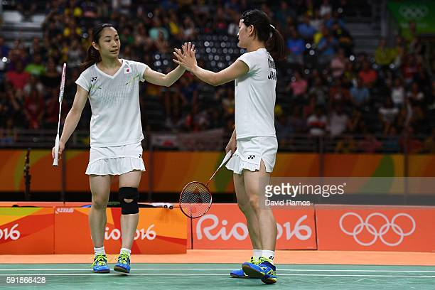Misaki Matsutomo and Ayaka Takahashi of Japan celebrate against Christinna Pedersen and Kamilla Rytter Juhl of Denmark during the Women's Doubles...