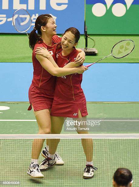 Misaki Matsutomo and Ayaka Takahashi of Japan celebrate victory against Reika Kakiiwa and Miyuki Maeda of Japan during day six of Badminton YONEX...